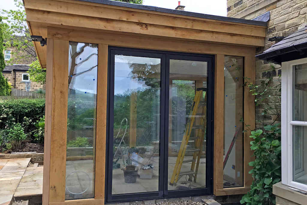 Reynaers CF77 Bi Fold doors installed at Baildon in West Yorkshire - side view 1