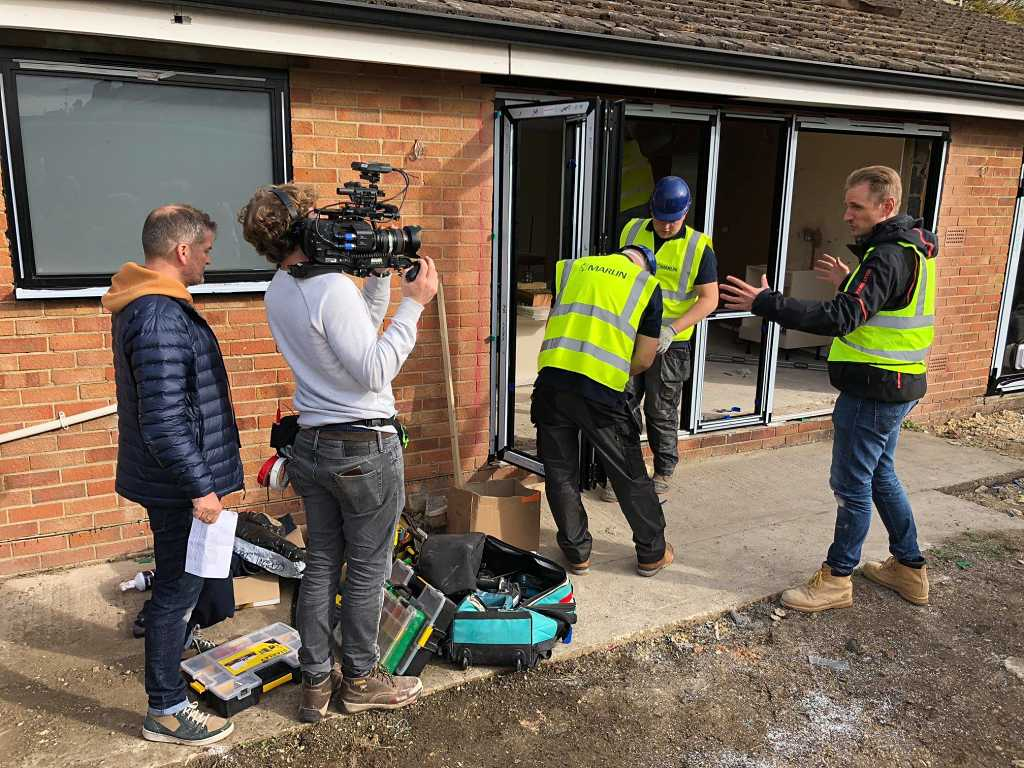 architect Ewald Van Der Straeten talks to camera during filming and installation of Visofold 1000 Bi Fold doors on Love Your Home & Garden