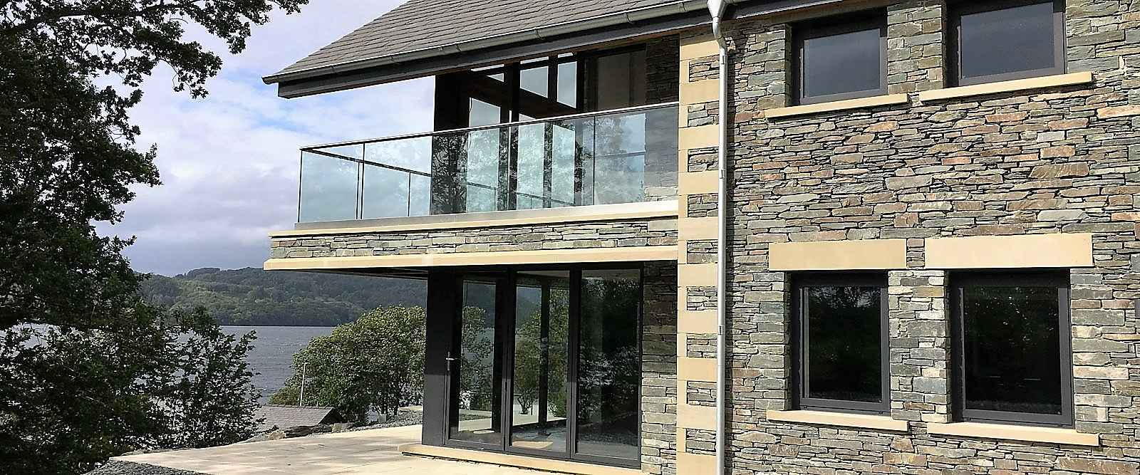 Aluminium Bi-fold doors installed in this stunning Lake District house by Marlin Windows