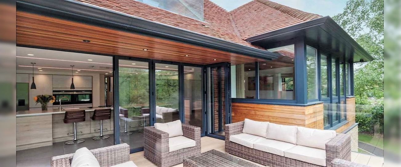 Visofold Aluminium Bi-fold doors connect house and garden