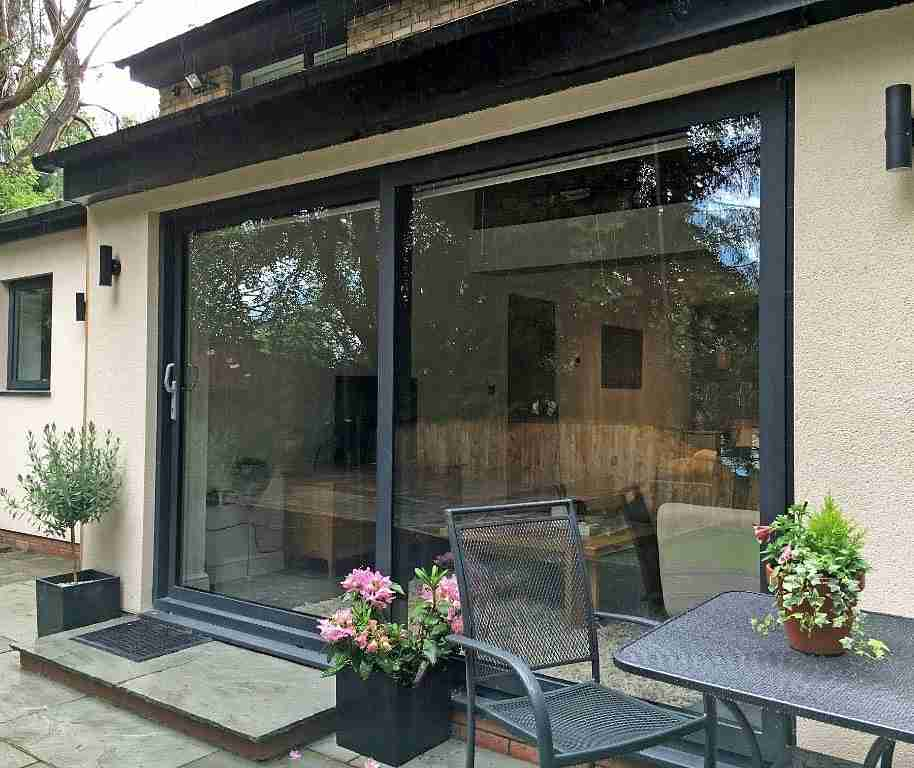 Sliding patio door image gallery marlin windows keighley for Backyard sliding door