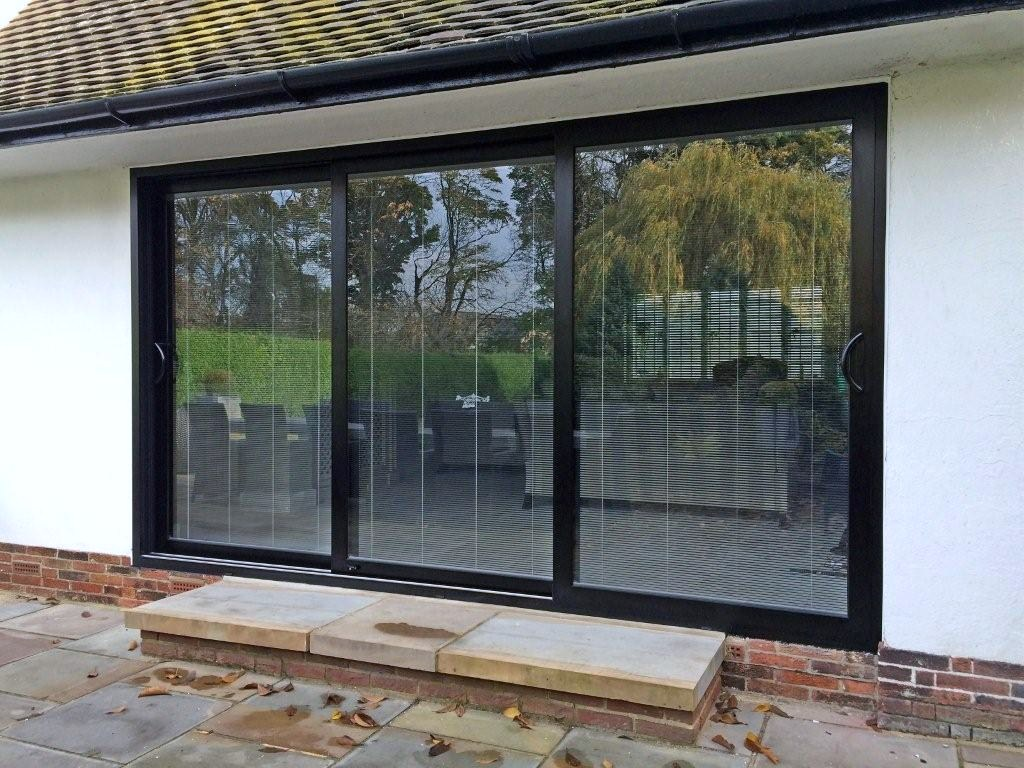 Sliding patio door alside products windows u0026 patio for Center sliding patio doors
