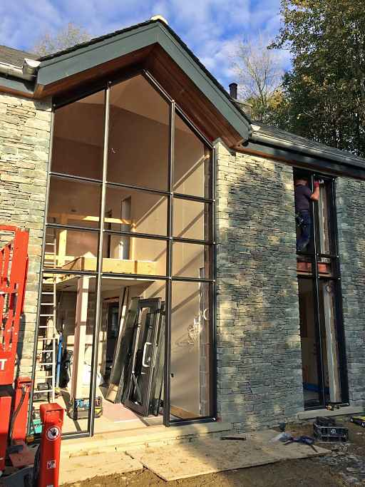 MC600 glass curtain wall aluminium window installation at Lake Windermere in Cumbria - side view