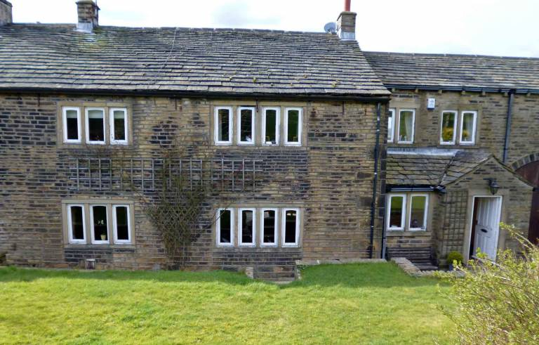 Before crittal steel window replacement at grade II listed farm house in Elland Halifax West Yorkshire.