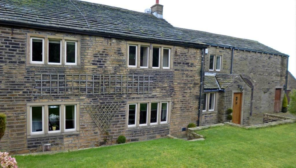 Heritage Alitherm 47 installed on this grade II listed farmhouse at Elland, Halifax