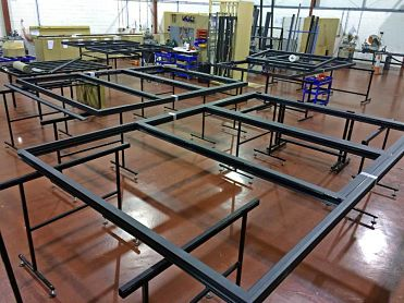 manufactured aluminium bi-fold door frames laid out in the factory
